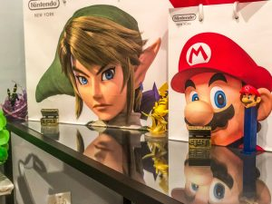 Pokémon figurines, Nintendo Store Bags, and Mario Pez dispenser