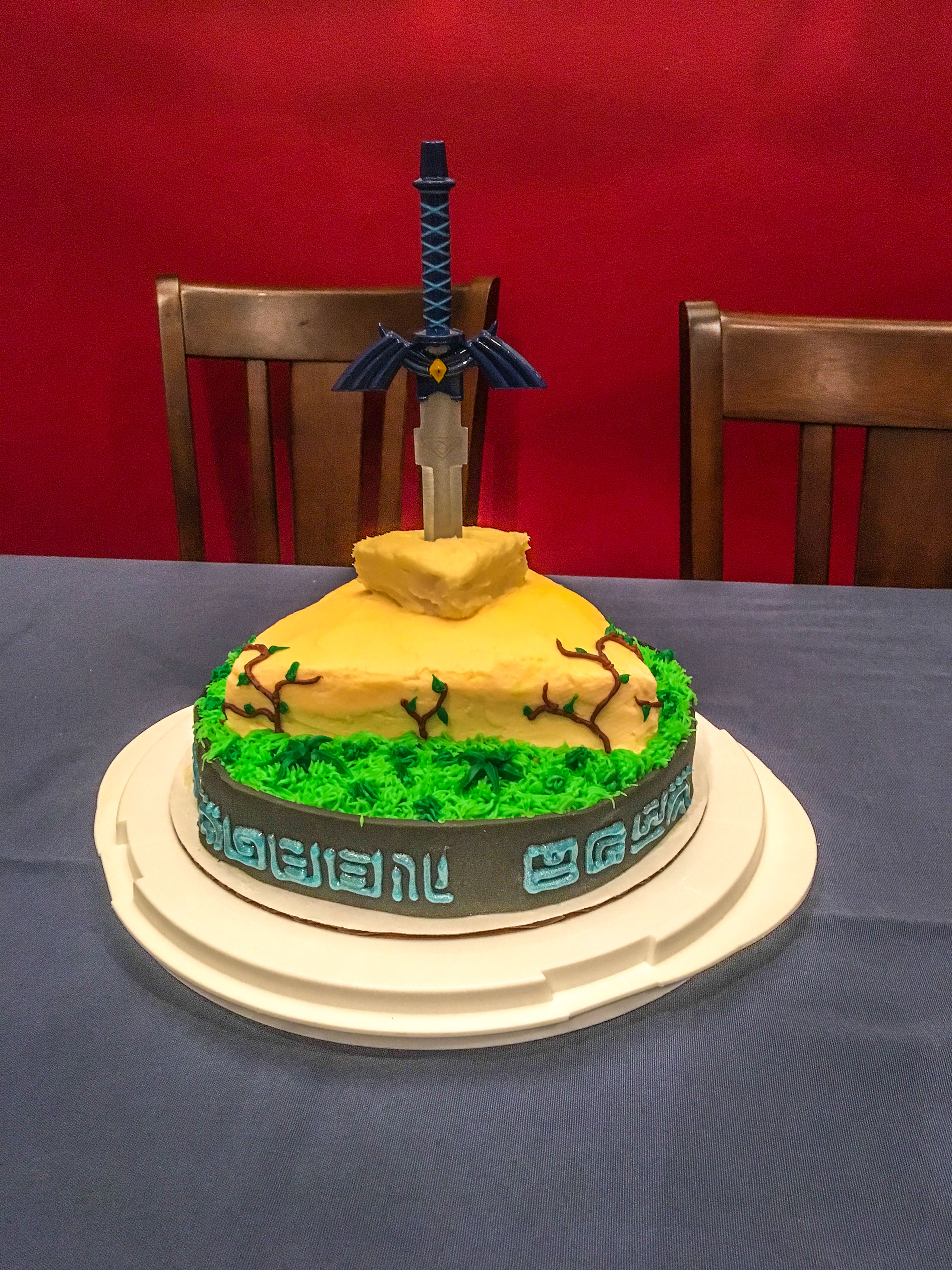 Birthday cake in the shape of the Korok forest Master Sword platform from Legend of Zelda: Breath of the Wild